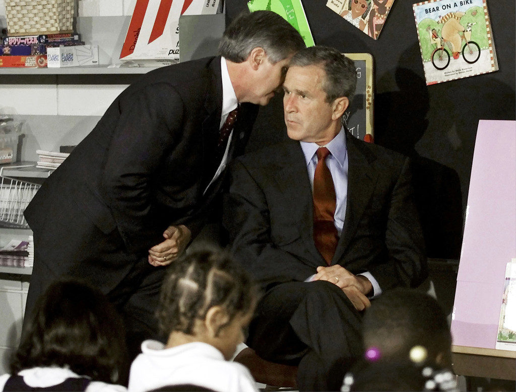 A September 11, 2001 file photo shows U.S. President George W. Bush listens as White House Chief of Staff Andrew Card informs him of a second plane hitting the World Trade Center, while Bush was conducting a reading seminar at the Emma E. Booker Elementary School in Sarasota, Florida. New York City plans to mark the third anniversary of the attacks on the trade center with an observance at the site on September 11 with parents and grandparents of victims reading their names. REUTERS/Win McNamee